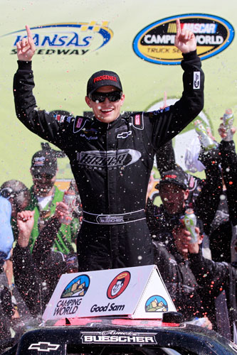 James Buescher celebrates in Kansas Speedway's Victory Lane after winning the NASCAR Camping World Truck Series SFP 250 on Saturday in Kansas City, Kan. (Credit: Chris Graythen/Getty Images for NASCAR)