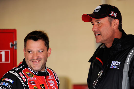 Tony Stewart, driver of the No. 14 Office Depot/Mobil 1 Chevrolet, talks with crew chief Steve Addington in the garage during practice for the NASCAR Sprint Cup Series STP 400 at Kansas Speedway on Friday in Kansas City, Kan. (Credit: John Harrelson/Getty Images for NASCAR)