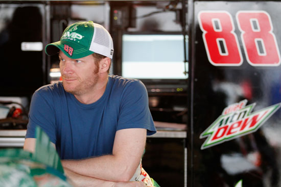 Dale Earnhardt Jr., driver of the #88 AMP Energy/National Guard Chevrolet, looks on in the garage area during practice for the NASCAR Sprint Cup Series FedEx 400 benefiting Autism Speaks at Dover International Speedway on June 1, 2012 in Dover, Delaware. (Photo by Rob Carr/Getty Images for NASCAR)
