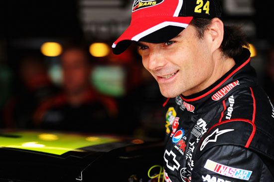 Jeff Gordon, driver of the #24 DuPont Chevrolet, looks on in the garage area during practice for the NASCAR Sprint Cup Series FedEx 400 benefiting Autism Speaks at Dover International Speedway on June 1, 2012 in Dover, Delaware. (Photo by Patrick Smith/Getty Images for NASCAR)