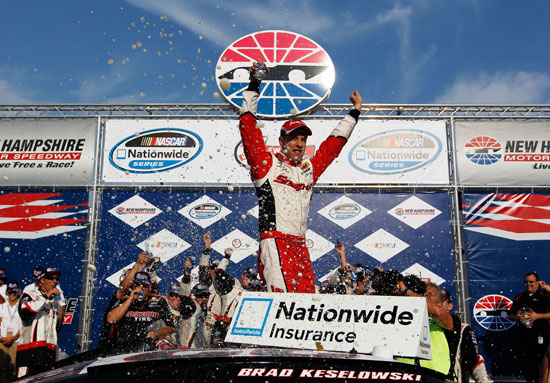 Brad Keselowski celebrates winning the F.W. Webb 200 at New Hampshire Motor Speedway. (Credit: Tom Pennington/Getty Images for NASCAR)