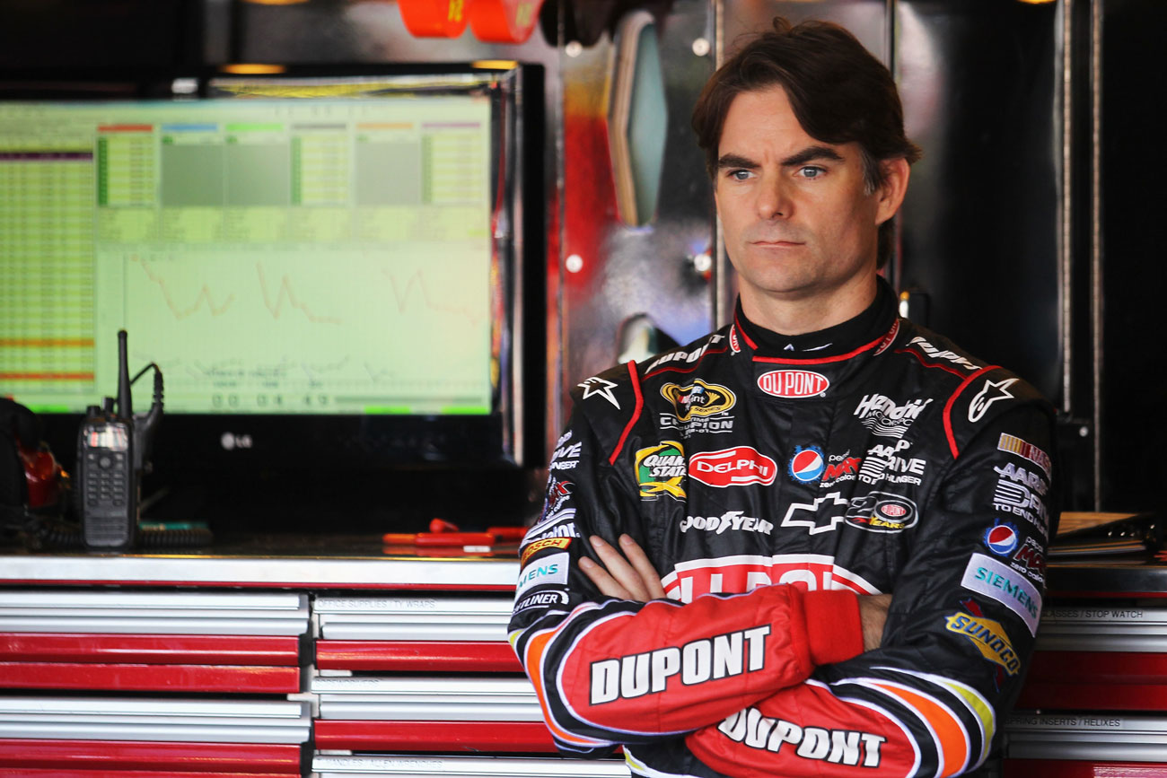 2012-Phoenix2-Jeff-Gordon-Stands-In-Garage-During-Practice