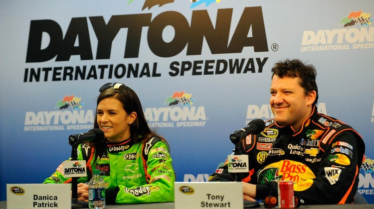 Danica Patrick (L), driver of the #10 Chevrolet, and Tony Stewart, driver of the #14 Chevrolet, speak with the media during NASCAR Sprint Cup Series Preseason Thunder testing at Daytona International Speedway on January 10, 2013 in Daytona Beach, Florida. (Credit: Jared C. Tilton/Getty Images for NASCAR)