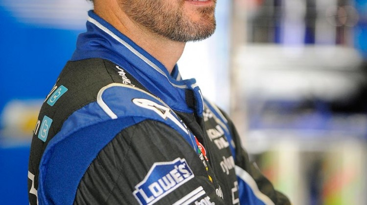 Jimmie Johnson, driver of the #48 Chevrolet, stands in the garage area during NASCAR Sprint Cup Series Preseason Thunder testing at Daytona International Speedway on January 11, 2013 in Daytona Beach, Florida. (Credit: Jared C. Tilton/Getty Images for NASCAR)