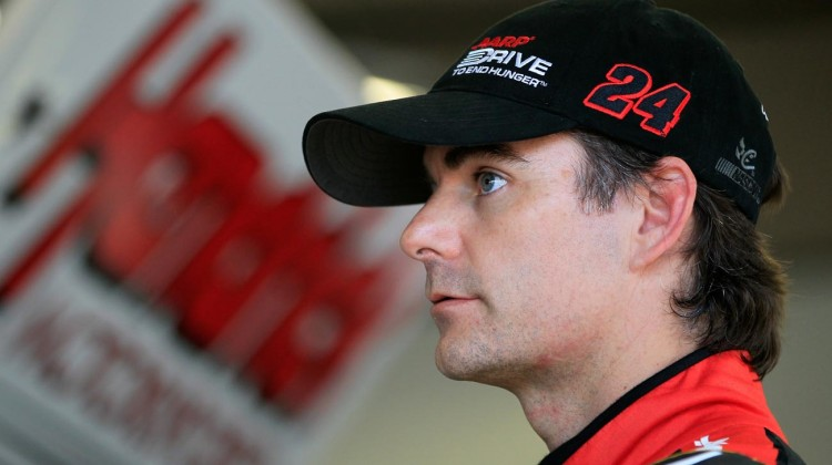 Jeff Gordon, driver of the #24 Chevrolet, stands in the garage during the NASCAR Sprint Cup Series Preseason Thunder testing at Daytona International Speedway on January 10, 2013 in Daytona Beach, Florida. (Credit: Chris Trotman/Getty Images for NASCAR)