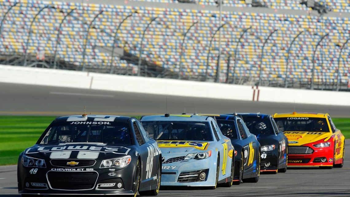 The new Generation 6 NASCAR Sprint Cup cars sit on the grid during NASCAR Sprint Cup Series Preseason Thunder testing at Daytona International Speedway on January 10, 2013 in Daytona Beach, Florida. (Credit: Jared C. Tilton/Getty Images for NASCAR)