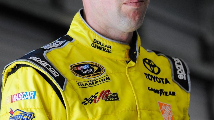 Matt Kenseth, driver of the #20 Toyota, stands in the garage area during NASCAR Sprint Cup Series Preseason Thunder testing at Daytona International Speedway on January 11, 2013 in Daytona Beach, Florida. (Credit: Jared C. Tilton/Getty Images for NASCAR)