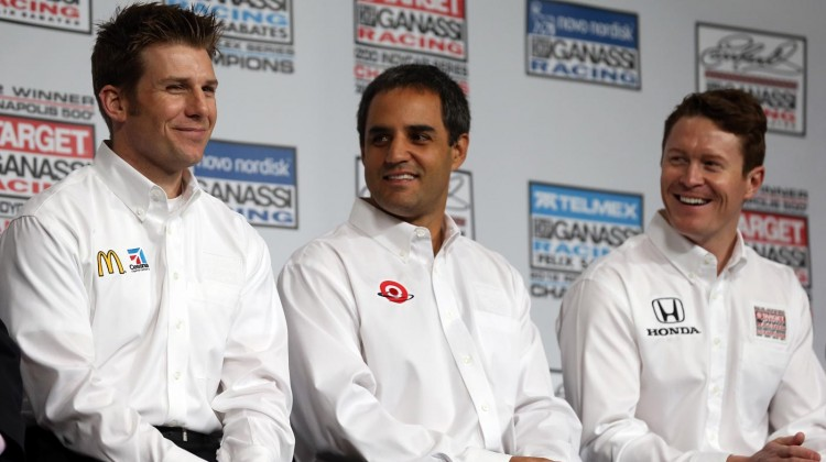 (L-R) Earnhardt Ganssi Racing teammates Jamie McMurray and Juan Pablo Montoya are introduced as Scott Dixon watches on during the 2013 NASCAR Sprint Media Tour on January 23, 2013 in Concord, North Carolina. (Credit: Streeter Lecka/Getty Images for NASCAR)