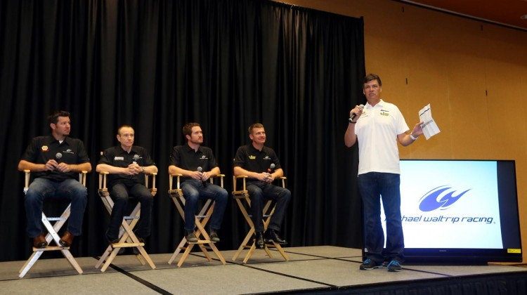 (L-R) Drivers Martin Truex Jr., Mark Martin, Brian Vickers and Clint Bowyer are introduced to the media by team owner, Michael Waltrip, of MWR Racing during the 2013 NASCAR Sprint Media Tour on January 22, 2013 in Concord, North Carolina. (Credit: Streeter Lecka/Getty Images for NASCAR)