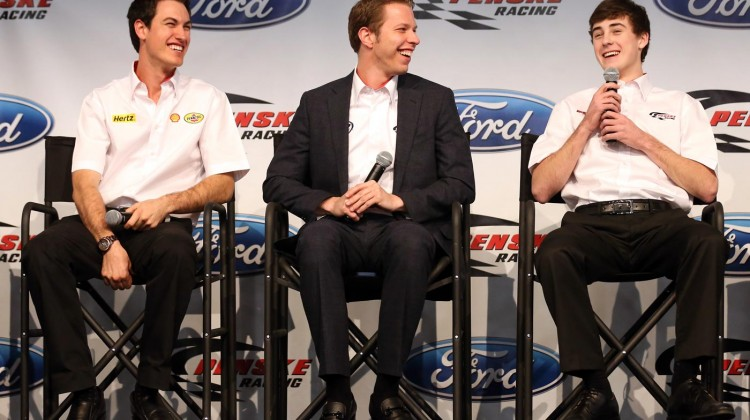 (L-R) Joey Logano and Brad Keselowski, teammates at Penske Racing, listen as Ryan Blaney speaks to the media during the 2013 NASCAR Sprint Media Tour on January 23, 2013 in Concord, North Carolina.(Credit: Streeter Lecka/Getty Images for NASCAR)