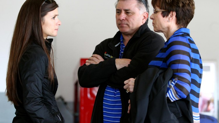 Danica Patrick (L), driver of the #10 GoDaddy.com Chevrolet, talks with her parents T.J. (C) and Bev (R) in the garage during practice for the NASCAR Sprint Cup Series Daytona 500 at Daytona International Speedway on February 20, 2013 in Daytona Beach, Florida. (Credit: Jonathan Ferrey/Getty Images)
