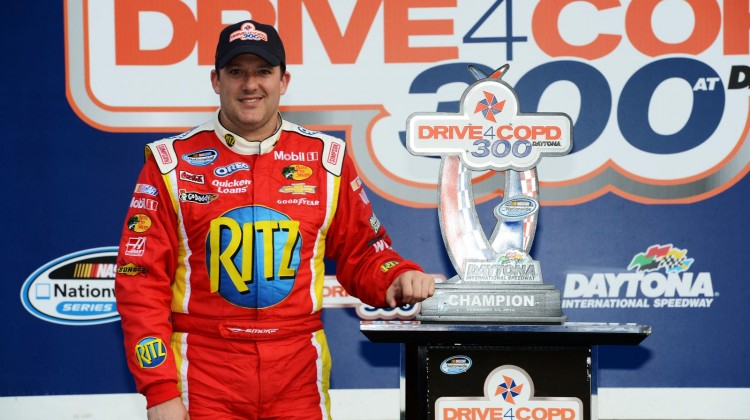 Tony Stewart, driver of the #33 Oreo/Ritz Chevrolet, poses with the trophy after winning the NASCAR Nationwide Series DRIVE4COPD 300 at Daytona International Speedway on February 23, 2013 in Daytona Beach, Florida. (Credit: John Harrelson/Getty Images for NASCAR)