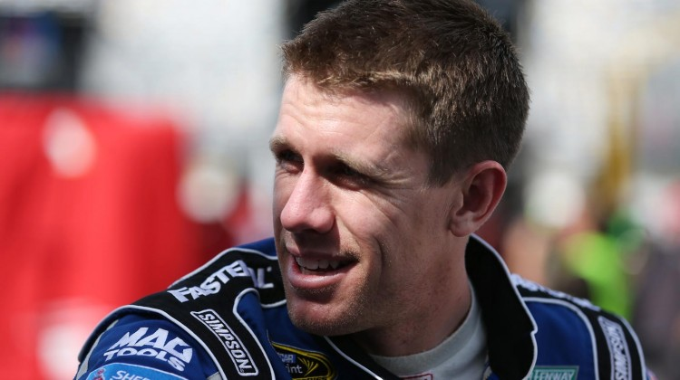 Carl Edwards, driver of the #99 Fastenal Ford, looks on before practice for the NASCAR Sprint Cup Series Daytona 500 at Daytona International Speedway on February 22, 2013 in Daytona Beach, Florida. (Credit: Tom Pennington/NASCAR via Getty Images)