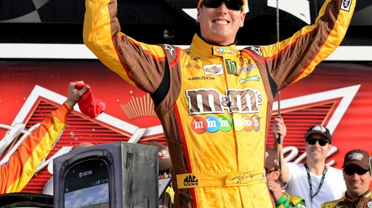 Kyle Busch, driver of the #18 M&M's Toyota, celebrates in Victory Lane after winning the NASCAR Sprint Cup Series Budweiser Duel 2 at Daytona International Speedway on February 21, 2013 in Daytona Beach, Florida. (Photo by Jared C. Tilton/NASCAR via Getty Images)