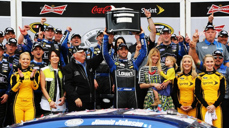 Jimmie Johnson, driver of the #48 Lowe's Chevrolet, hoists the Harley J. Earl trophy after winning the NASCAR Sprint Cup Series Daytona 500 at Daytona International Speedway on February 24, 2013 in Daytona Beach, Florida. (Photo by Jerry Markland/Getty Images)