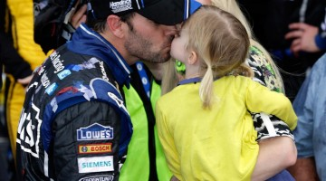 Jimmie Johnson, driver of the #48 Lowe's Chevrolet SS, celebrates his victory in the Daytona 500 NASCAR Sprint Cup Series race with wife Chandra and daughter Genevieve Marie Sunday, February 24, 2013 at Daytona International Speedway in Daytona Beach, Florida. (Photo by Harold Hinson for Chevrolet)