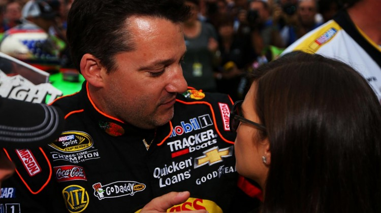 Tony Stewart, driver of the #14 Bass Pro Shops/Mobil 1 Chevrolet, talks to Danica Patrick, driver of the #10 GoDaddy.com Chevrolet, on the grid during pre-race ceremonies for the NASCAR Sprint Cup Series Daytona 500 at Daytona International Speedway on February 24, 2013 in Daytona Beach, Florida. (Photo by Mike Ehrmann/Getty Images)
