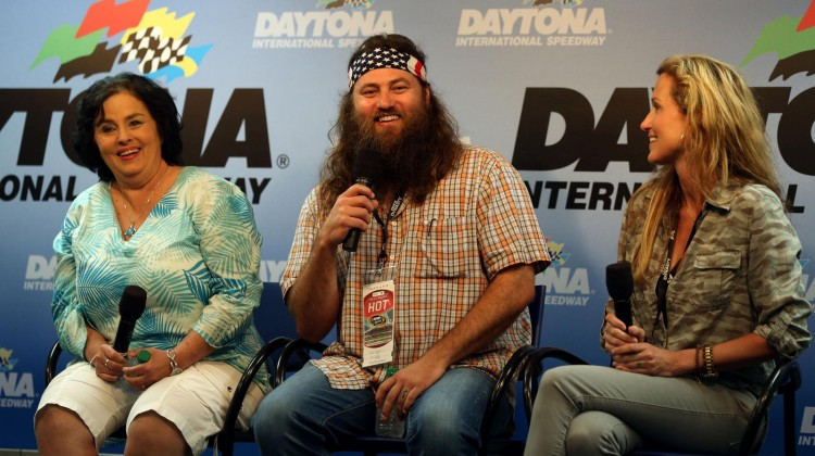 Duck Dynasty cast members (L-R) Kay Robertson, Willie Robertson and Korie Robertson speak to the media prior to the NASCAR Sprint Cup Series Daytona 500 at Daytona International Speedway on February 24, 2013 in Daytona Beach, Florida. (Photo by Matthew Stockman/Getty Images)