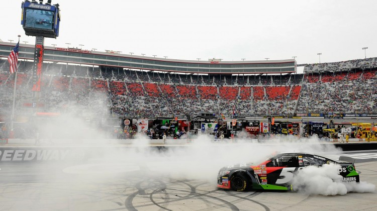 Kasey Kahne, driver of the #5 Great Clips Chevrolet, celebrates with a burnout after winning the NASCAR Sprint Cup Series Food City 500 at Bristol Motor Speedway on March 17, 2013 in Bristol, Tennessee. (Credit: Jared C. Tilton/Getty Images)