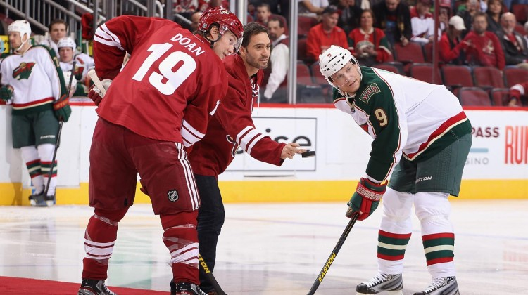 Driver Jimmie Johnson dropped the first ceremonial puck at a Coyotes game in Phoenix, AZ on February 28, 2013. (Credit: Christian Petersen/Getty Images)