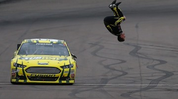 Carl Edwards, driver of the #99 Subway Ford, performs a back flip to celebrate after winning the NASCAR Sprint Cup Series Subway Fresh Fit 500 at Phoenix International Raceway on March 3, 2013 in Avondale, Arizona. (Credit: Jerry Markland/Getty Images)