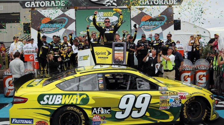 Carl Edwards, driver of the #99 Subway Ford, celebrates in victory lane after winning the NASCAR Sprint Cup Series Subway Fresh Fit 500 at Phoenix International Raceway on March 3, 2013 in Avondale, Arizona. (Credit: Jonathan Ferrey/Getty Images)