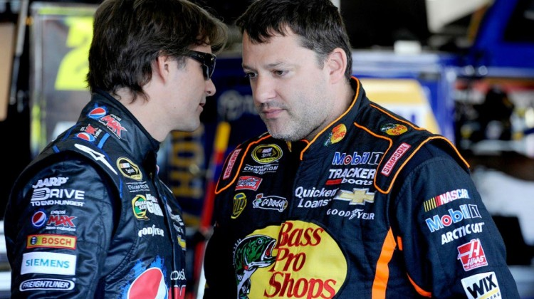 Jeff Gordon (left), driver of the NASCAR Sprint Cup #24 Pepsi MAX Chevrolet SS talks with Tony Stewart, driver of the #14 Bass Pro Shops Chevrolet SS Friday, March 1, 2013 at Phoenix International Raceway in Phoenix, Arizona. (Photo by Rusty Jarrett for Chevrolet)