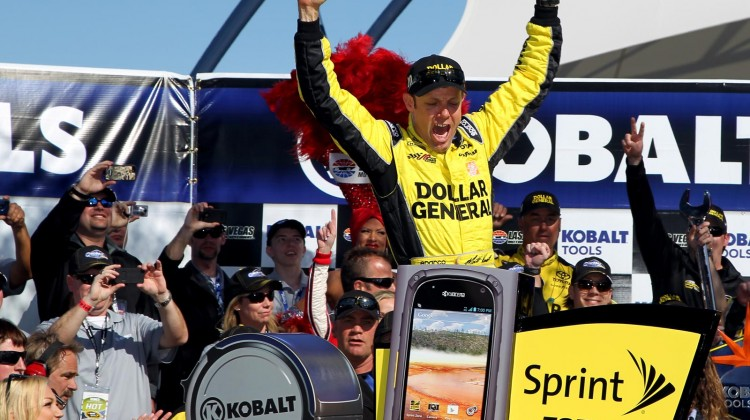 Matt Kenseth, driver of the #20 Dollar General Toyota, celebrates in Victory Lane after winning the NASCAR Sprint Cup Series Kobalt Tools 400 at Las Vegas Motor Speedway on March 10, 2013 in Las Vegas, Nevada. (Photo by Todd Warshaw/Getty Images)