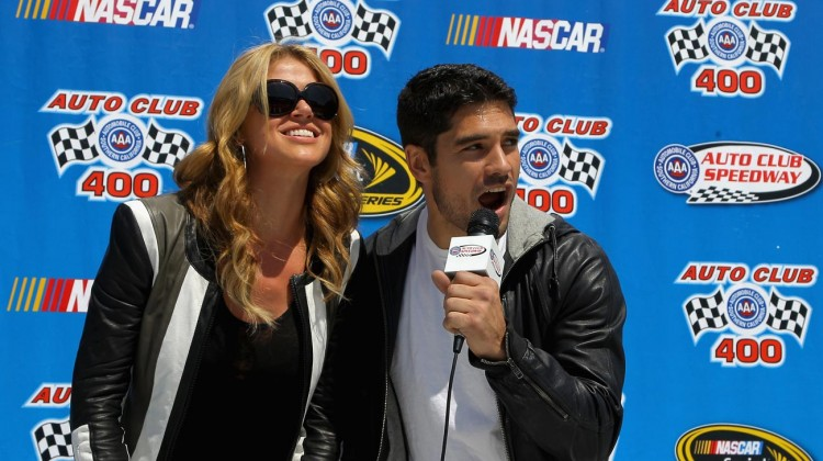 Grand Marshals D.J. Cotrona (R) and Actress Adrianne Palicki (L) give the command for drivers to start their engines prior to the NASCAR Sprint Cup Series Auto Club 400 at Auto Club Speedway on March 24, 2013 in Fontana, California. (Photo by Justin Edmonds/NASCAR via Getty Images)