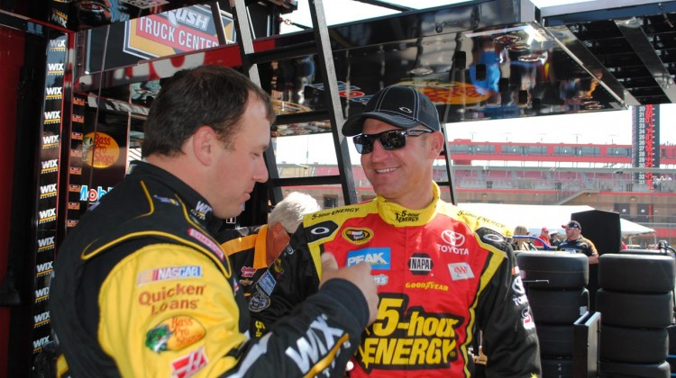 Clint Bowyer (right) chats with Ryan Newman before qualifying at Auto Club Speedway. (Credit: Heather Baker / The Fast and the Fabulous)