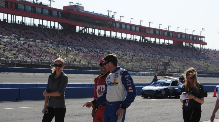 David Ragan walks pit road with Dave Blaney before qualifying at Auto Club Speedway. (Credit: Heather Baker / The Fast and the Fabulous)