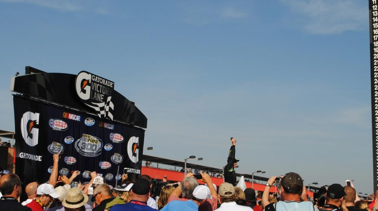 Kyle Busch is victorious at Auto Club Speedway. (Credit: Heather Baker / The Fast and the Fabulous)