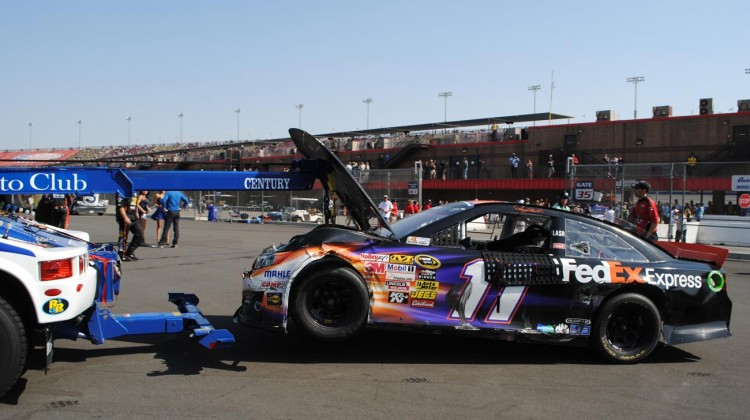 Denny Hamlin's wrecked car. (Credit: Heather Baker / The Fast and the Fabulous)