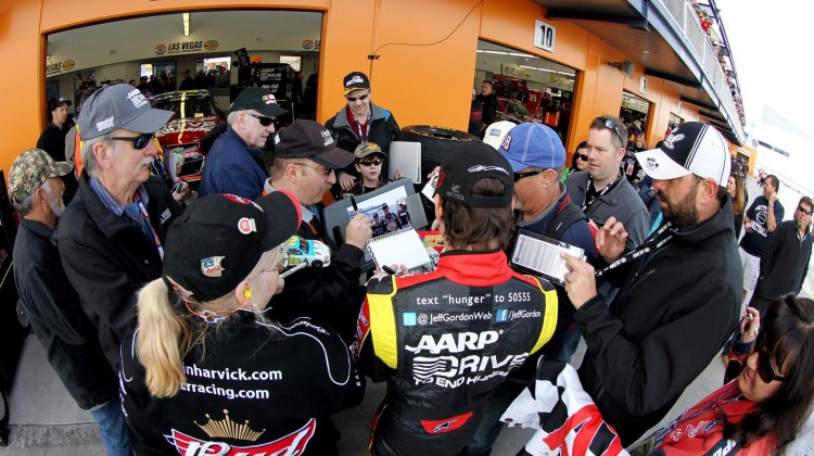 Jeff Gordon, driver of the #24 Drive To End Hunger Chevrolet, signs autographs in the garage area during practice for the NASCAR Sprint Cup Series Kobalt Tools 400 at Las Vegas Motor Speedway on March 9, 2013 in Las Vegas, Nevada. (Photo by Todd Warshaw/Getty Images)
