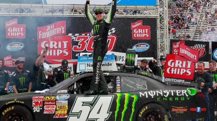 Kyle Busch, driver of the #54 Monster Energy Toyota, celebrates in Victory Lane after winning the NASCAR Nationwide Series Jeff Foxworthy's Grit Chips 300 at Bristol Motor Speedway on March 16, 2013 in Bristol, Tennessee. (Photo by Geoff Burke/Getty Images)