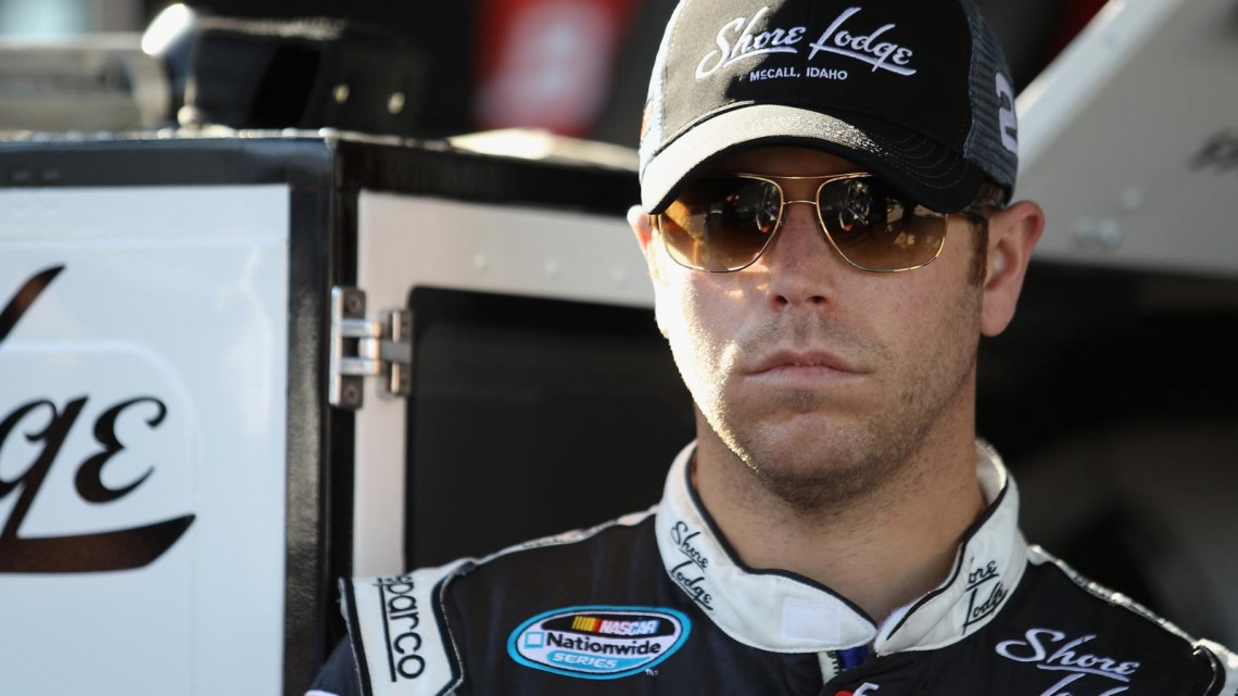Brian Scott, driver of the #2 Shore Lodge Chevrolet, stands in the garage area during practice for the NASCAR Nationwide Series ToyotaCare 250 at Richmond International Raceway on April 25, 2013 in Richmond, Virginia. (Credit: Todd Warshaw/NASCAR via Getty Images)