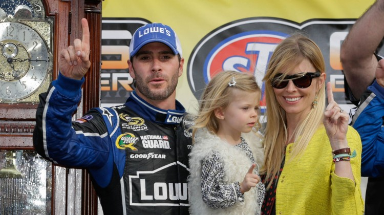 Jimmie Johnson, driver of the NASCAR Sprint Cup #48 Lowe's Chevrolet SS celebrates his victory with his wife, Chandra, and their daughter, Genevieve Marie, Sunday, April 7, 2013 at Martinsville Speedway after winning the STP Gas Booster 500 in Martinsville, Virginia. (Photo by Harold Hinson for Chevrolet)