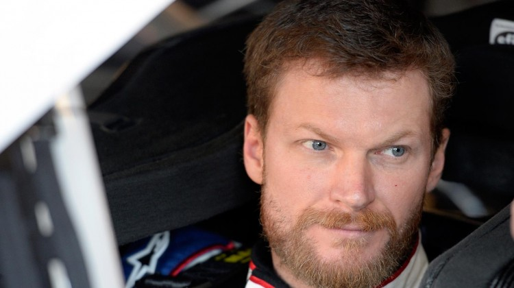 Dale Earnhardt Jr., driver of the #88 National Guard Chevrolet, sits in his car during practice for the NASCAR Sprint Cup Series STP 400 at Kansas Speedway on April 19, 2013 in Kansas City, Kansas. (Photo by John Harrelson/NASCAR via Getty Images)