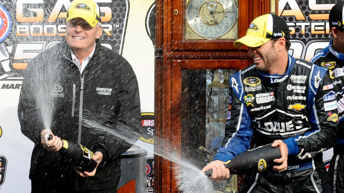 Jimmie Johnson, driver of the #48 Lowe's Chevrolet, celebrates in Victory Lane after winning the NASCAR Sprint Cup Series STP Gas Booster 500 on April 7, 2013 at Martinsville Speedway in Ridgeway, Virginia. (Photo by Rainier Ehrhardt/NASCAR via Getty Images)