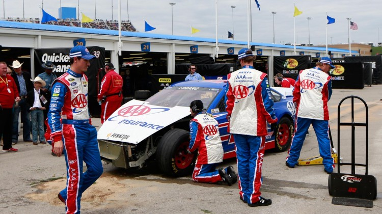 Joey Logano, driver of the #22 AAA Ford, walks past his damaged car in the garage area after an incident during the NASCAR Sprint Cup Series STP 400 at Kansas Speedway on April 21, 2013 in Kansas City, Kansas. (Photo by Chris Trotman/Getty Images)