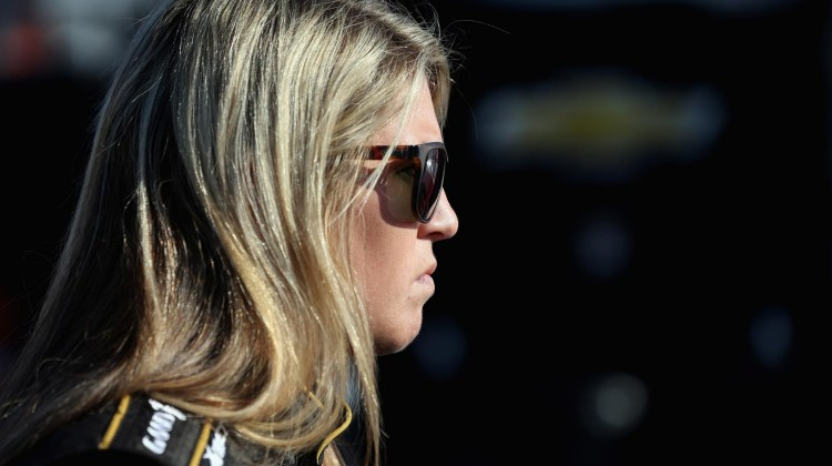 Johanna Long, driver of the #70 ForeTravel Motorcoach Chevrolet, stands in the garage area during practice for the NASCAR Nationwide Series ToyotaCare 250 at Richmond International Raceway on April 26, 2013 in Richmond, Virginia. (Photo by Streeter Lecka/Getty Images)