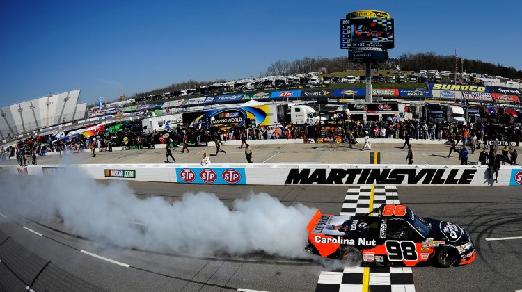 Johnny Sauter, driver of the #98 Carolina Nut Co./Curb Records Toyota, celebrates with a burnout after winning the NASCAR Camping World Truck Series Kroger 250 on April 6, 2013 at Martinsville Speedway in Ridgeway, Virginia. (Photo by Jared C. Tilton/NASCAR via Getty Images)