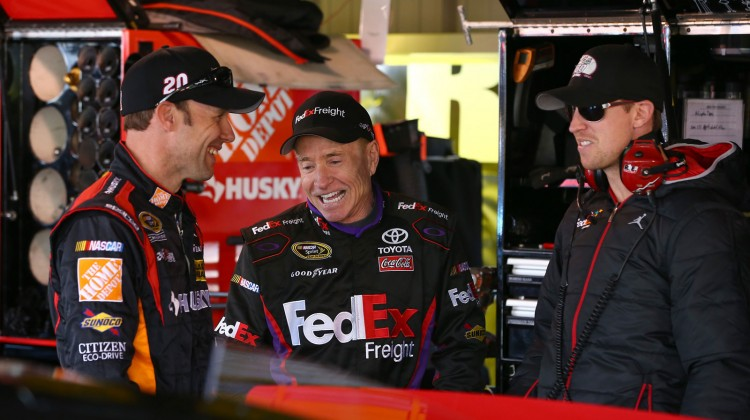 (L-R) Matt Kenseth, driver of the #20 The Home Depot/Husky Toyota, talks with Mark Martin, driver of the #11 FedEx Freight Toyota, and driver Denny Hamlin during practice for the NASCAR Sprint Cup Series STP Gas Booster 500 on April 6, 2013 at Martinsville Speedway in Ridgeway, Virginia. (Photo by Tom Pennington/NASCAR via Getty Images)