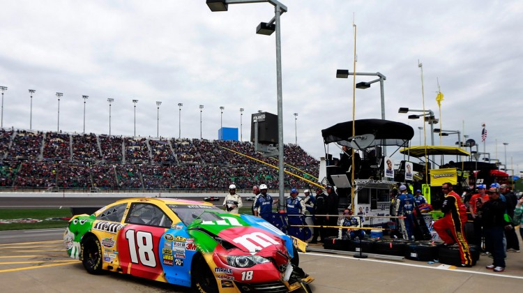 Kyle Busch, driver of the #18 M&M's Toyota, drives his damaged car into the garage area during the NASCAR Sprint Cup Series STP 400 at Kansas Speedway on April 21, 2013 in Kansas City, Kansas. (Photo by Chris Trotman/Getty Images)