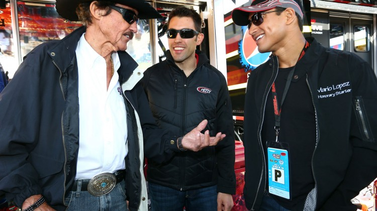 Actor Mario Lopez visits with Richard Petty and Aric Almirola, driver of the #43 Jani-King/STP Ford, during the NASCAR Sprint Cup Series STP Gas Booster 500 on April 7, 2013 at Martinsville Speedway in Ridgeway, Virginia. (Photo by Tom Pennington/NASCAR via Getty Images)