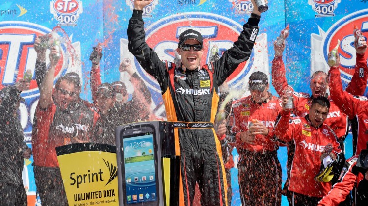 Matt Kenseth, driver of the #20 The Home Depot/Husky Toyota, celebrates in Victory Lane after winning the NASCAR Sprint Cup Series STP 400 at Kansas Speedway on April 21, 2013 in Kansas City, Kansas. (Photo by John Harrelson/NASCAR via Getty Images)