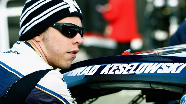 Brad Keselowski, driver of the #2 Miller Lite Ford, stands in the garage area during practice for the NASCAR Sprint Cup Series STP 400 at Kansas Speedway on April 20, 2013 in Kansas City, Kansas. (Photo by Jeff Zelevansky/Getty Images)