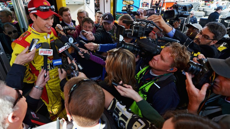Joey Logano, driver of the #22 Shell Pennzoil Ford, is interviewed after practice for the NASCAR Sprint Cup Series STP Gas Booster 500 on April 5, 2013 at Martinsville Speedway in Ridgeway, Virginia. (Photo by Drew Hallowell/Getty Images)