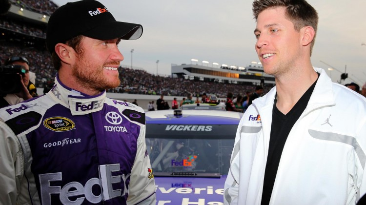 (L-R) Brian Vickers, driver of the #11 FedEx Delivery Manager Toyota, and injured driver Denny Hamlin during the NASCAR Sprint Cup Series Toyota Owners 400 at Richmond International Raceway on April 27, 2013 in Richmond, Virginia. (Credit: Streeter Lecka/Getty Images)