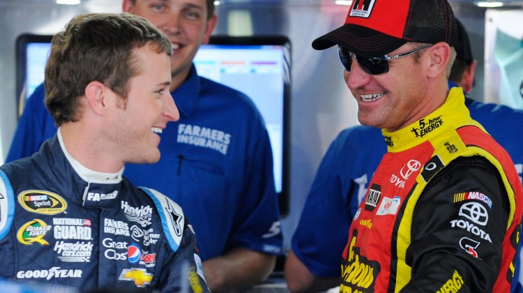 Kasey Kahne(L), driver of the #5 Farmers Insurance Chevrolet, speaks with Clint Bowyer, driver of the #15 5-hour ENERGY Toyota, in the garage area during practice for the NASCAR Sprint Cup Series All-Star Race at Charlotte Motor Speedway on May 17, 2013 in Concord, North Carolina. (Credit: Jared C. Tilton/Getty Images)